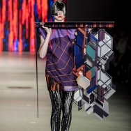 Marga Weimans A/W 2013 - Model holding an acrylic panel construction with 3D effect