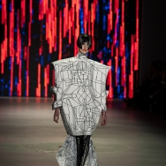 Marga Weimans A/W 2013 - Model wearing a graphic box shaped top combined with flowy silk dress